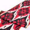 Black Spinners Red Ikat Fabric